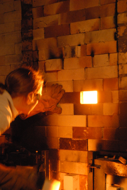 Mandy Parslow, checking the cones during the firing of the wood fired salt glaze kiln in Tipperary.